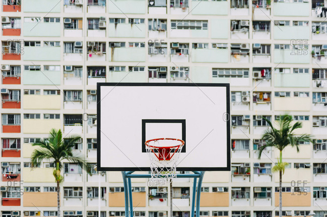 China- Hong Kong- Kowloon- basketball hoop- public housing in the background