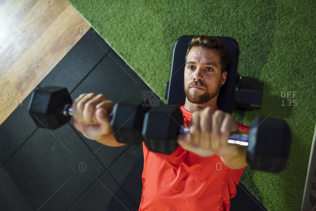 Man training with dumbbells in a gym