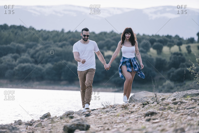 Couple in love walking hand in hand in nature