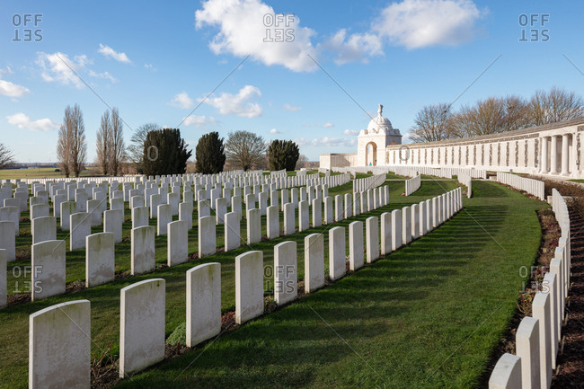 Zonnebeke, Belgium - February 12, 2018: Memorial wall and graves at Tyne Cot Cemetery, the largest British military cemetery in the world