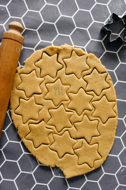 Gingerbread dough with cut cookies shapes