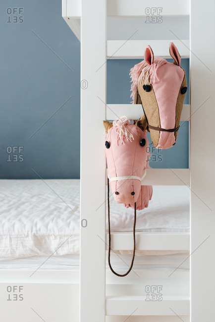 Two pink horses on ladder of bunk bed