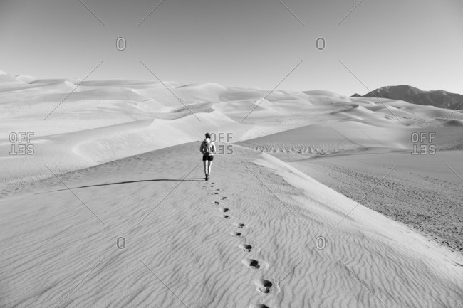 Woman walking at Great Sand Dunes National Park and Preserve