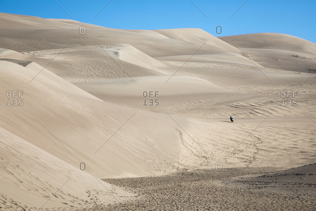 Person walking at Great Sand Dunes National Park and Preserve