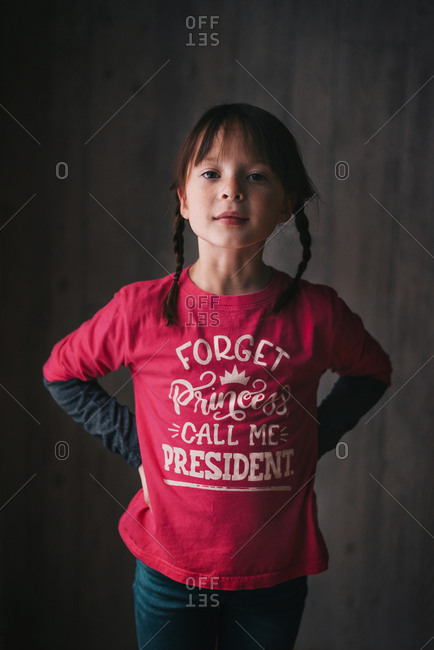 A strong young girl wearing positive messaging