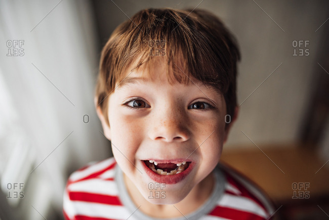 Portrait of a young boy with missing front teeth