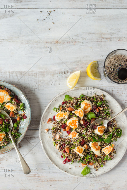 Mixed quinoa salad with grilled halloumi cheese, dried cranberries, almonds and fresh coriander