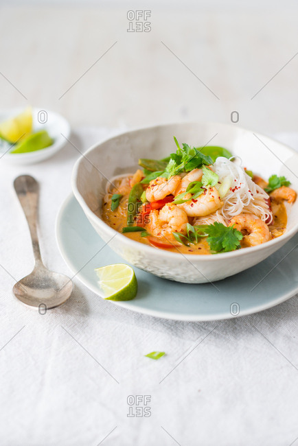 Red Thai prawn coconut curry with vegetables and rice noodles