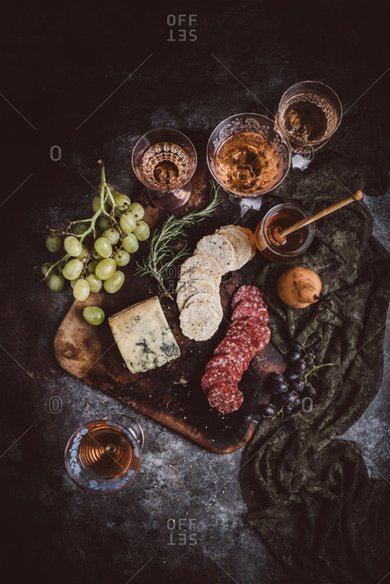 Cheeseboard and wine on dark background