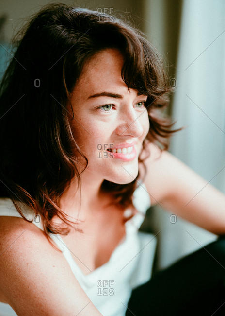 Brunette woman smiling and looking away