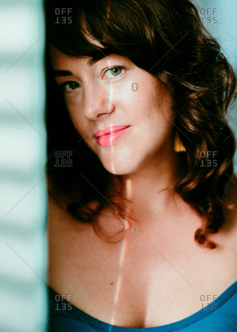 Brunette woman smiling and looking at camera