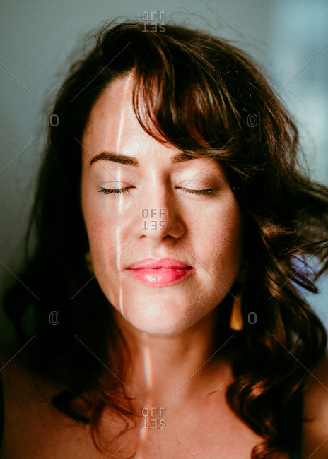 Portrait of a brunette woman with her eyes closed