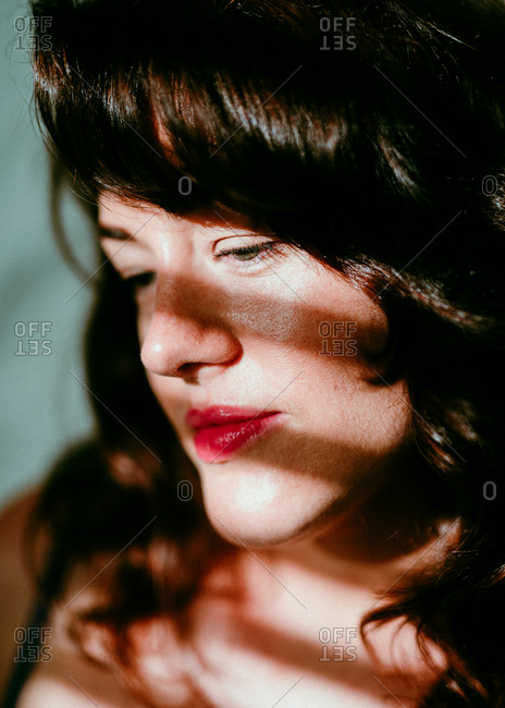 Brunette woman solemnly looking away