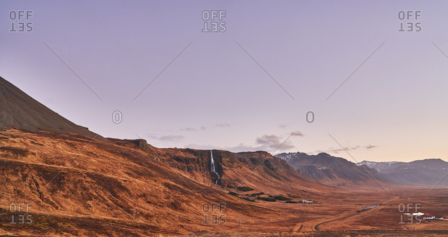 Mountain and small distant waterfall in Iceland