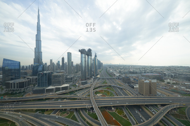 Dubai, United Arab Emirates - November 26, 2018: Intersecting highways and modern buildings in Dubai