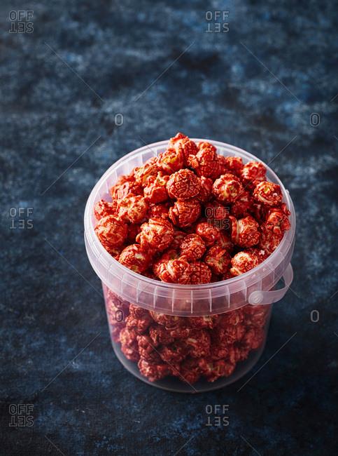 Gourmet strawberry popcorn in a bucket