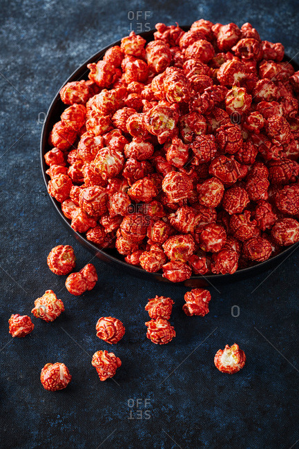 Gourmet strawberry popcorn overflowing from a plate