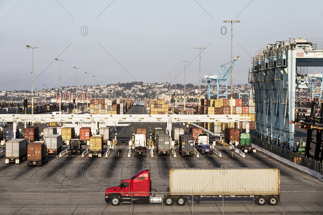 Los Angeles, California, USA - July 19, 2018: Semi-trailer truck at industrial port with cargo containers