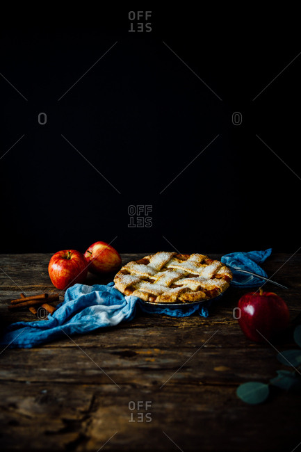 Freshly baked apple pie with whole apples