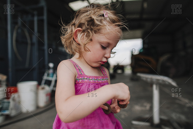 A girl playing with metal rings