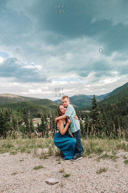 A mother and son embracing