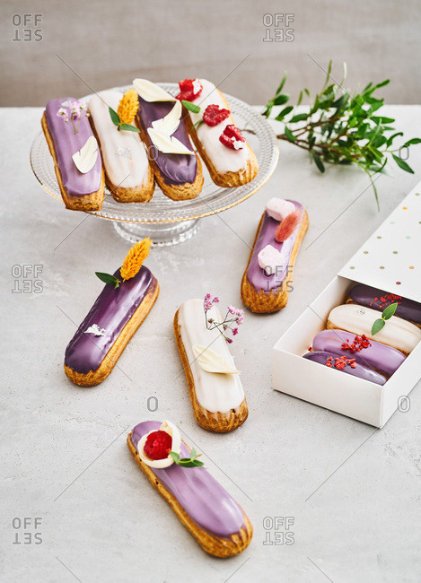 A variety of tasty eclairs on a table