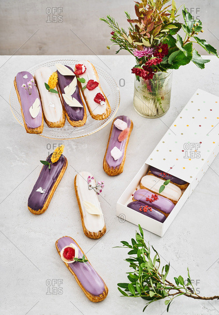Overhead view of a variety of tasty eclairs on a table