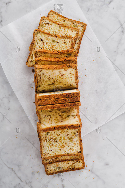 Overhead view of sliced fresh baked loaf of bread