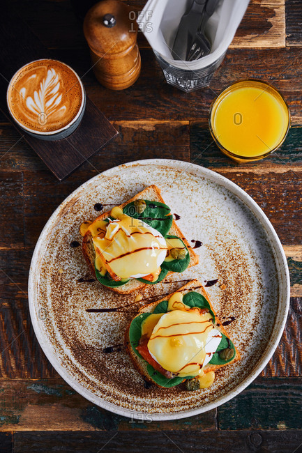 Eggs Florentine with spinach, salmon and hollandaise sauce with latte