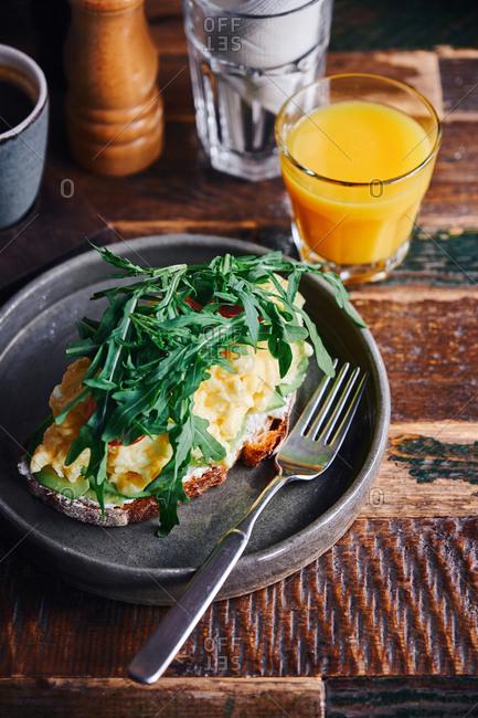 Tasty egg dish served with orange juice