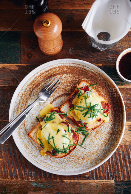 Eggs Florentine with spinach, salmon and hollandaise sauce with coffee