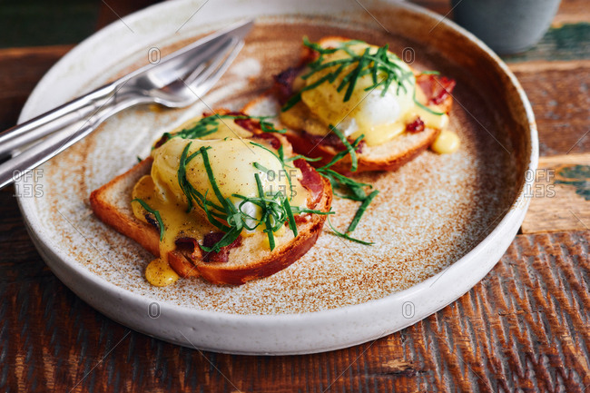 Close up of eggs Florentine with spinach, salmon and hollandaise sauce