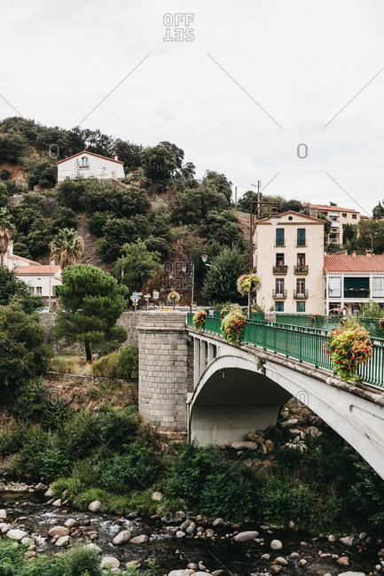 August 25, 2018 - Historic bridge over a river in a hillside village in France