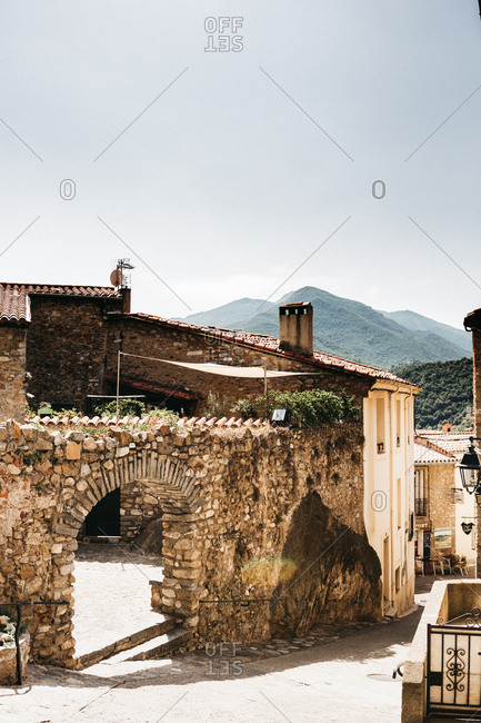 August 25, 2018 - Stone arch at the entrance to a historic building in a French village in the Pyrenees mountains