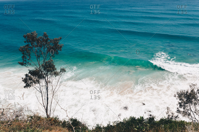 Scenic view of ocean waves breaking in Byron Bay