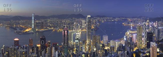 May 20, 2018: Skyline of Hong Kong Island and Kowloon from Victoria Peak at dusk, Hong Kong Island, Hong Kong, China, Asia