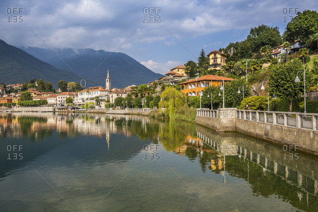 View of Mergozzo reflecting in Lake Mergozo, Piedmont, Italy, Europe