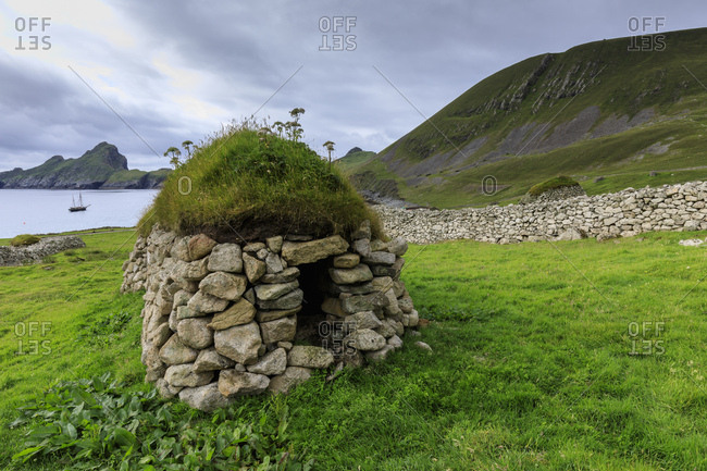 Cleit, food store and Village Bay, evacuated village, Hirta, remote St, Kilda Archipelago, UNESCO World Heritage Site, Outer Hebrides, Scotland, United Kingdom, Europe