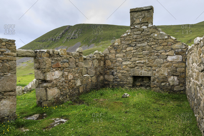 Stone remains of evacuated cottage with fireplace, Hirta, remote St. Kilda Archipelago, UNESCO World Heritage Site, Outer Hebrides, Scotland, United Kingdom, Europe