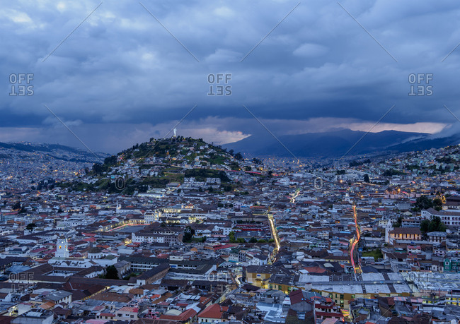 View over Old Town towards El Panecillo Hill at twilight, Quito, Pichincha Province, Ecuador, South America