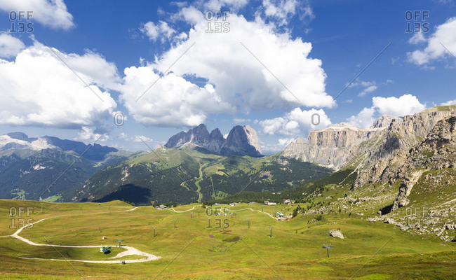Ski slopes in summer with Sassolungo Group in the background, Pordoi Pass, Fassa Valley, Trentino, Dolomites, Italy, Europe