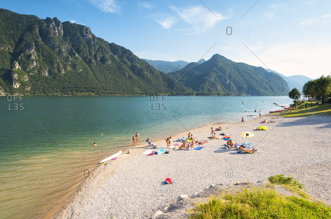 August 24, 2017: Bathers on the shores of Lake Idro, Valle Sabbia, Brescia province, Lombardy, Italy, Europe