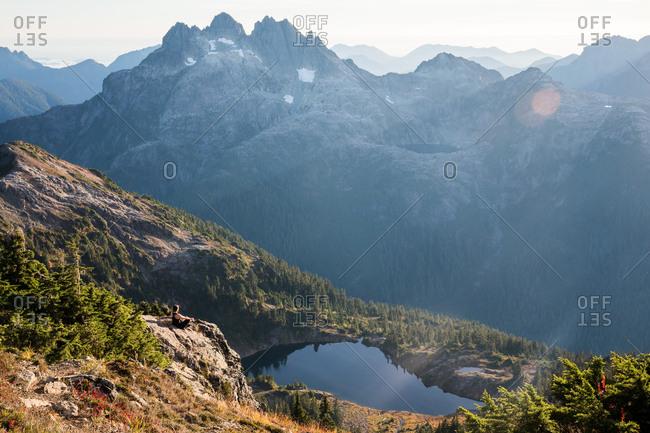 Sunny haze over mountain and lake