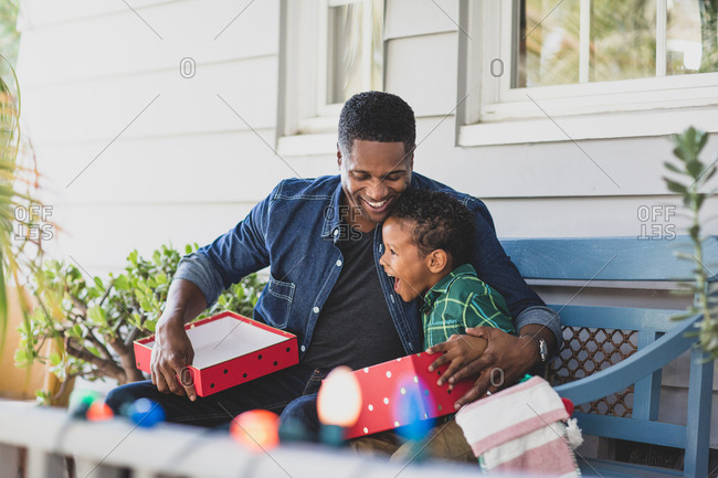 African American father giving son a christmas gift