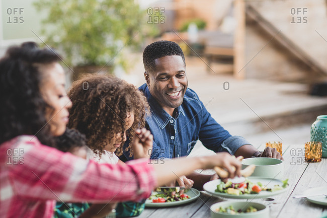 African American family having a family meal outdoors