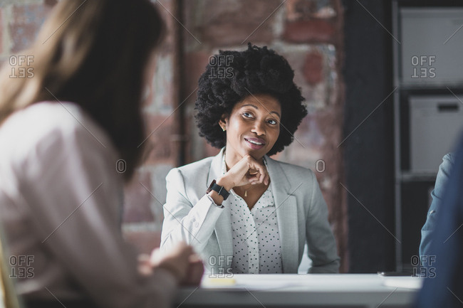African American businesswoman listening in a meeting