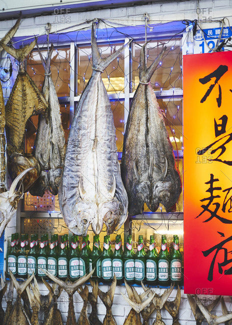 October 29, 2017: Dried fish hanging outside a shop in Taiwan