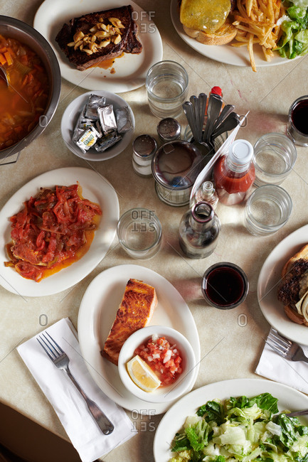 Gardnerville, Nevada - August 8, 2018: A group of Basque dishes including steak, chicken, with red peppers, and more