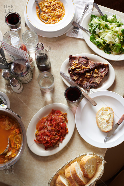 Gardnerville, Nevada - August 8, 2018: A group of Basque dishes including steak, chicken, with red peppers, and others
