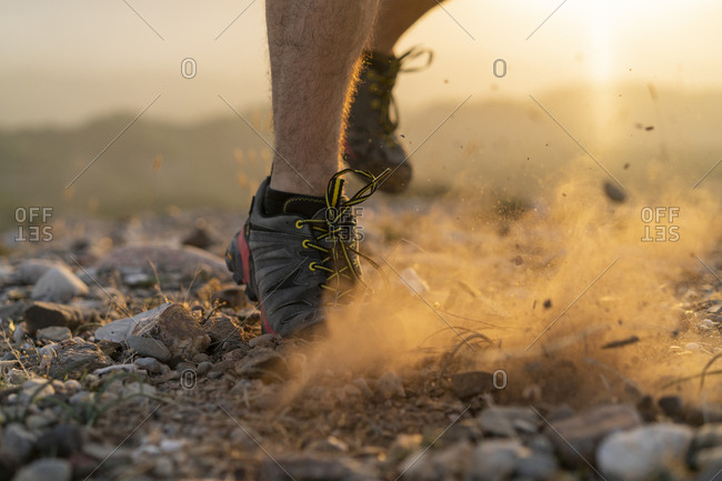 Close-up of feet of a trail runner